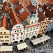 Houses with traditional red roofs in Old Town Square in Prague. — Stock Photo