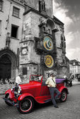 Retro car near the astronomical clock in Old Town Square waiting tourists for guided tour of the main attractions of the city on September 5, 2013 in Prague — Stock Photo