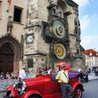 Stock Photo: Retro car near the astronomical clock in Old Town Square waiting tourists for guided tour of the main attractions of the city on September 5, 2013 in Prague