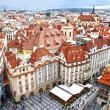 Houses with traditional red roofs in Old Town Square in Prague. — Stock Photo #38010817