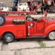 Red toy vintage metal car firetruck — Stock Photo #38543671