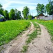 Ground road in small russian village — Stock Photo