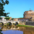 Saint Angel Castle and bridge over the Tiber river in Rome, Italy — Stock Photo #38543417