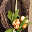 Stock Photo: Easter wreath. Spring decoration on wooden door of house