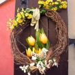 Easter wreath. Spring decoration on the wooden door of the house — Stock Photo #38543691