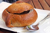 Soup in a bread bowl — Stock Photo