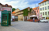 CESKY KRUMLOV, CZECH REPUBLIC- SEPTEMBER 08, 2013: Retro wooden telephone box on the old streets of Cesky Krumlov on September 08, 2013. The city was given a UNESCO World Heritage Site status in 1992. — Stock Photo