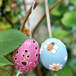 Colored Easter Eggs hanging on Ribbons on branch — Stock Photo #39334327