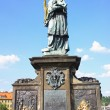 Stock Photo: Old relief below statue of St. John of Nepomuk on Charles Bridge in Prague, Czech Republic. According to legend touching it brings luck.