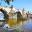Unidentified wedding couple on the waterside of the Vltava River near Charles Bridge in Prague, Czech Republic. — Stock Photo #39785625
