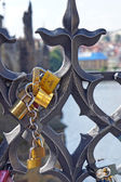 Love locks hang from on the Charles Bridge in Prague. European custom for newlyweds: secure friendship and romance — Stock Photo