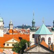 View from the Lesser tower on the Charles Bridge of Prague: domes of churches, towers and houses with traditional red roofs, Prague — Stock Photo