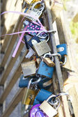 Love locks hang from on the Charles Bridge in Prague — Stock Photo