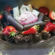 Chocolate cake with icing and fresh strawberry — Stock Photo