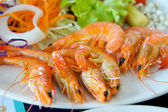 Tiger shrimp prawns with fresh lettuce in plate — Stock Photo