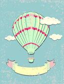 Vintage hot air balloon in blue sky. Greeting card. Vector illustration. — Stock Vector