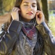 Woman listening music in park — Stock Photo