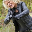 Screaming woman shooting from machine gun — Stock Photo