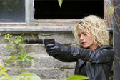 Female Spy with silencer handgun — Stock Photo