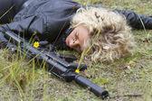 Dead Spy with machine gun — Stock Photo