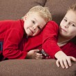 Stock Photo: Two boys lying on the sofa