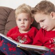 Two boys reading book — Stock Photo