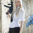 Blond woman with automatic gun — Stock Photo