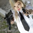 Angry woman with two guns — Stock Photo