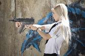 Spy with gun aiming — Stock Photo