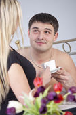 Couple on bed with coffee — Foto de Stock