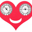 Stock Photo: Happy heart and normal blood pressure on scales