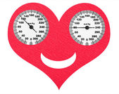 Happy heart and normal blood pressure on the scales — Stock Photo