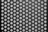 Black speaker grid texture — Stock Photo