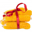 Ears of corn with red ribbon - Stock Photo