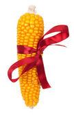 Espiga de milho com fita vermelha — Foto Stock