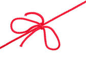 Knot and tie a red rope — Stock Photo