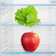 Stock Photo: Lettuce and apple in refrigerator