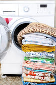 A washing machine and a big pile of laundry — Stock Photo