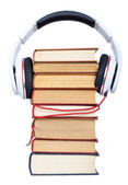 Pile books with headphone — Stock Photo