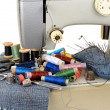 Sewing machine and threads — Stock Photo #23437744