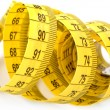 Twisted yellow measuring tape — Stock Photo