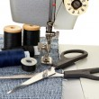 Stock Photo: Sewing machine and threads