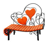 Wooden bench with hearts — Stock Photo