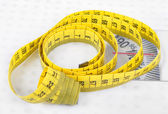 Measuring tape on scales — Stock Photo