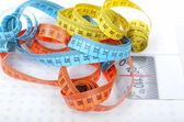 Measuring tapes on scales — Stock Photo