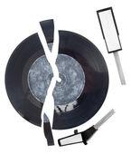 A broken arm and a vinyl disc — Stock Photo