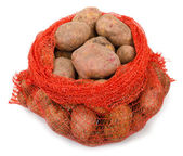 Potato tubers in the grid  container — Stock Photo