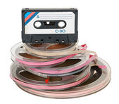 Pile of tape reels and cassette — Stock Photo