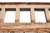 Empty window openings in the brick wall — Stock Photo
