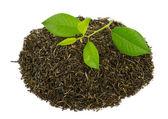 Black tea with leafs — Stock Photo
